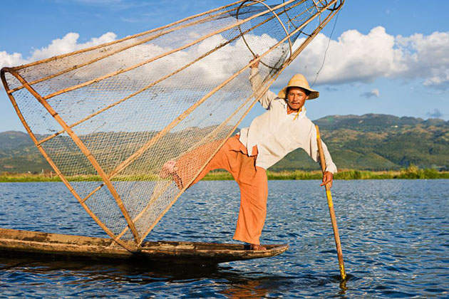Leg-rowing fishermen on Inle Lake are a major tourist destination in Myanmar (Burma).